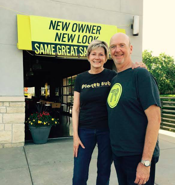 Doug and Linda Brantner stand in front of one of their two Wichita locations